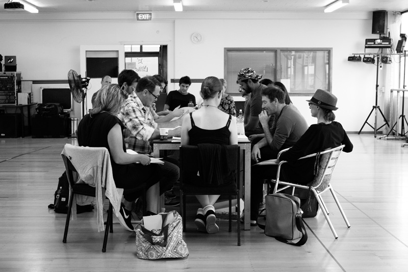 The cast of Angels in America in rehearsal