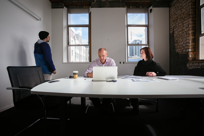 Simon Chesterman, Tim Martin and Kate Martin in the Coliseum offices.