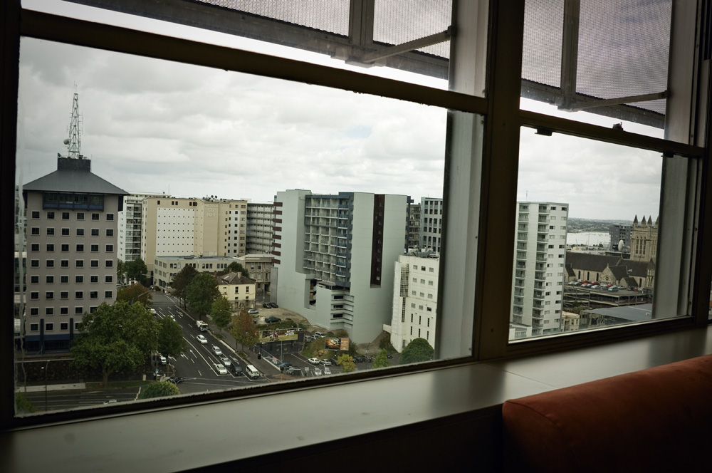 The councillors' lounge in Auckland's Civic Building looks out on the backs of apartment blocks, with the Central Police Station to the left.