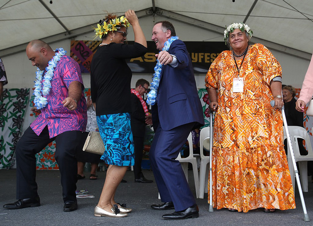 Prime Minister John Key gets in the spirit of Polyfest. Photo: Ben Campbell.
