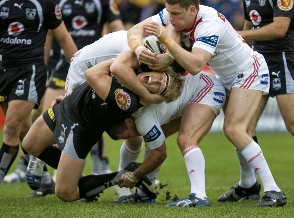 Warriors' player Micheal Luck is crunched in a tackle.