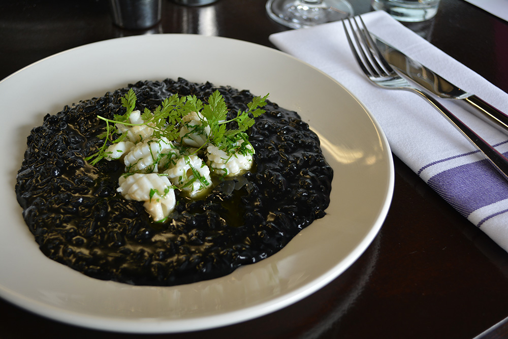 Squid ink risotto with chorizo at Ostro. Photo: Delaney Mes for Metro. All rights reserved.