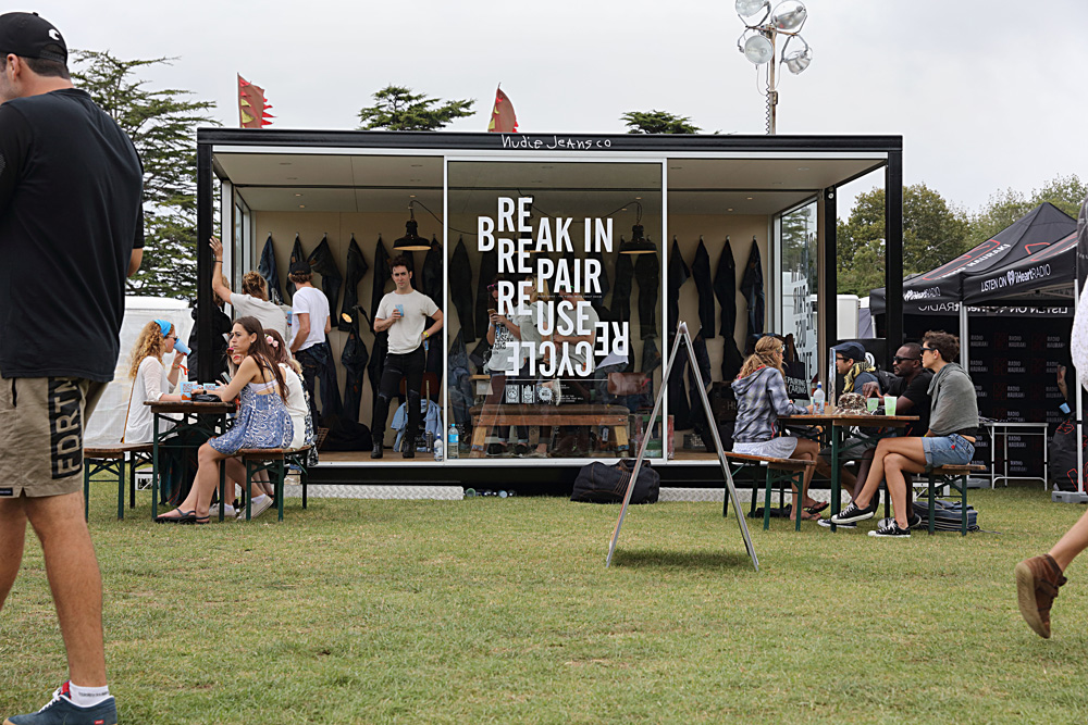 The Nudie Jeans pop-up repair station at the music festival, Auckland City Limits.