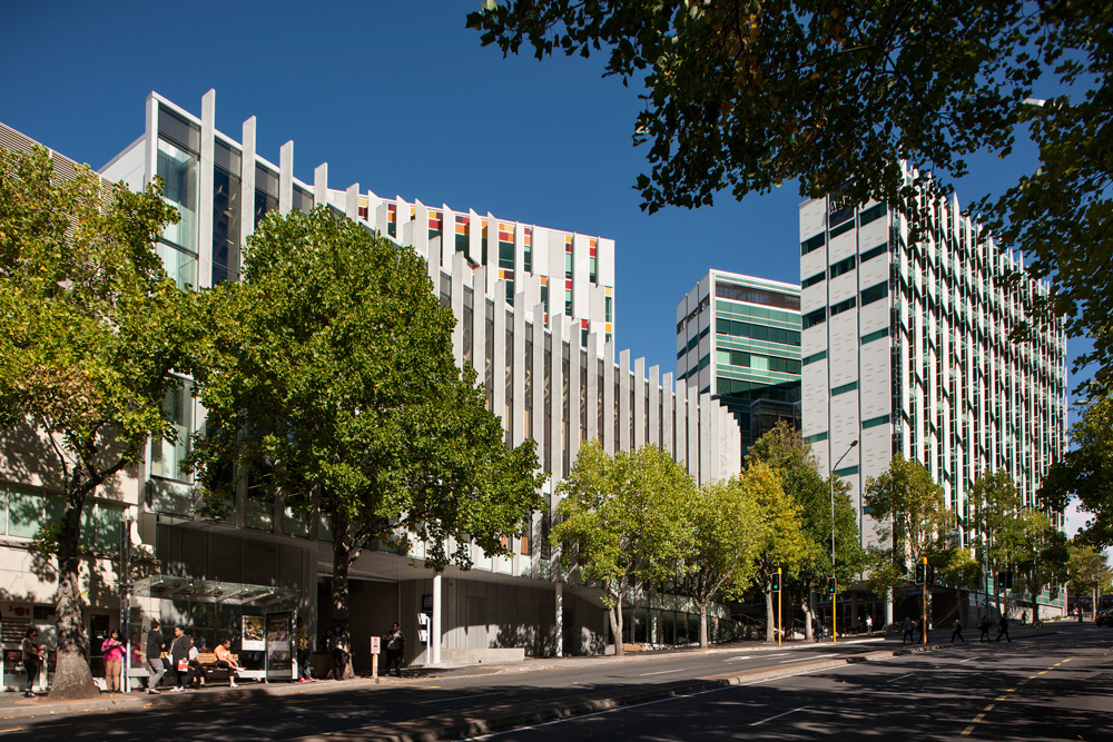 AUT's Governor Fitzroy Plaza (top) and the streetscape of university buildings as seen from Wakefield St Van Bohemen says Jasmax's AUT buildings work at street level as well as on the skyline.