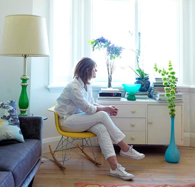 Carolyn Haslett in her corner courtville apartment.