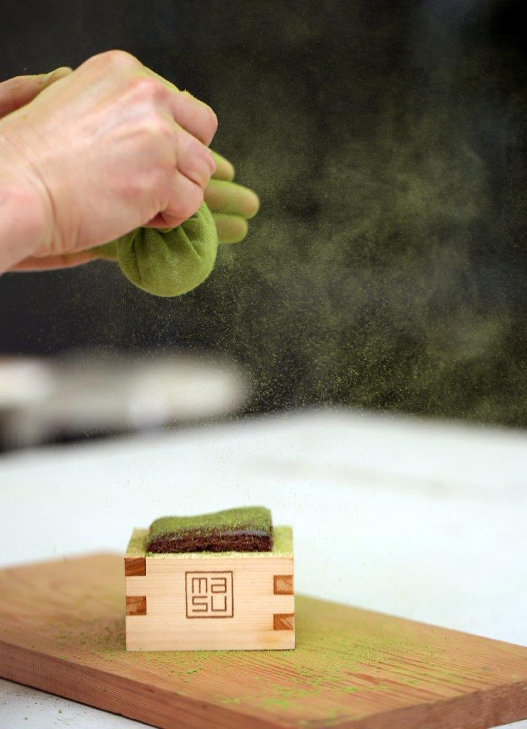 Chocolate pudding with green tea dusting credit Michael Bradley