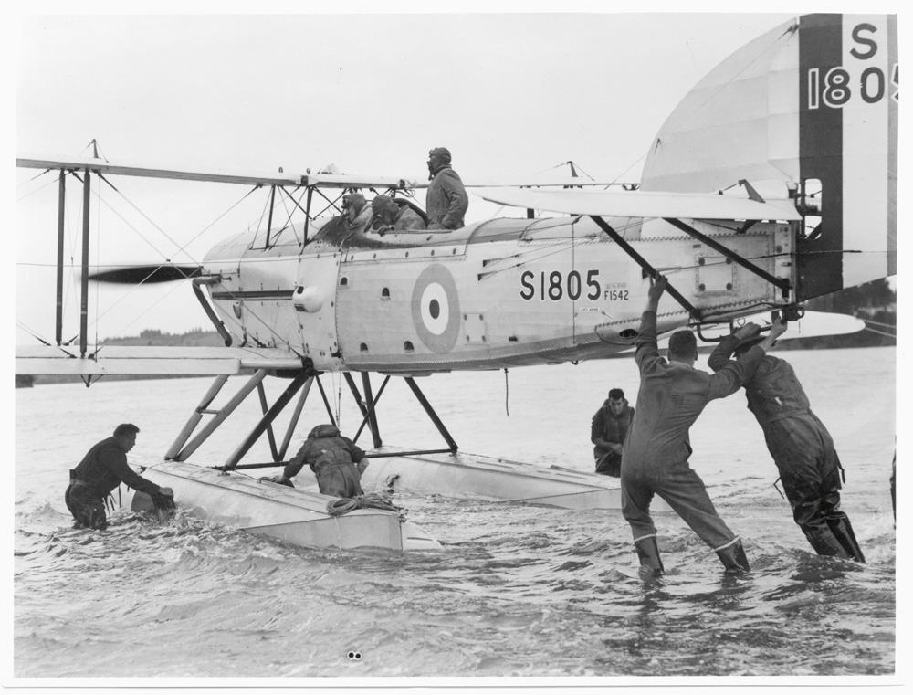The Fairey IIIF floatplane at Hobsonville Air Base. Wallingford is in the pilot's cockpit.
