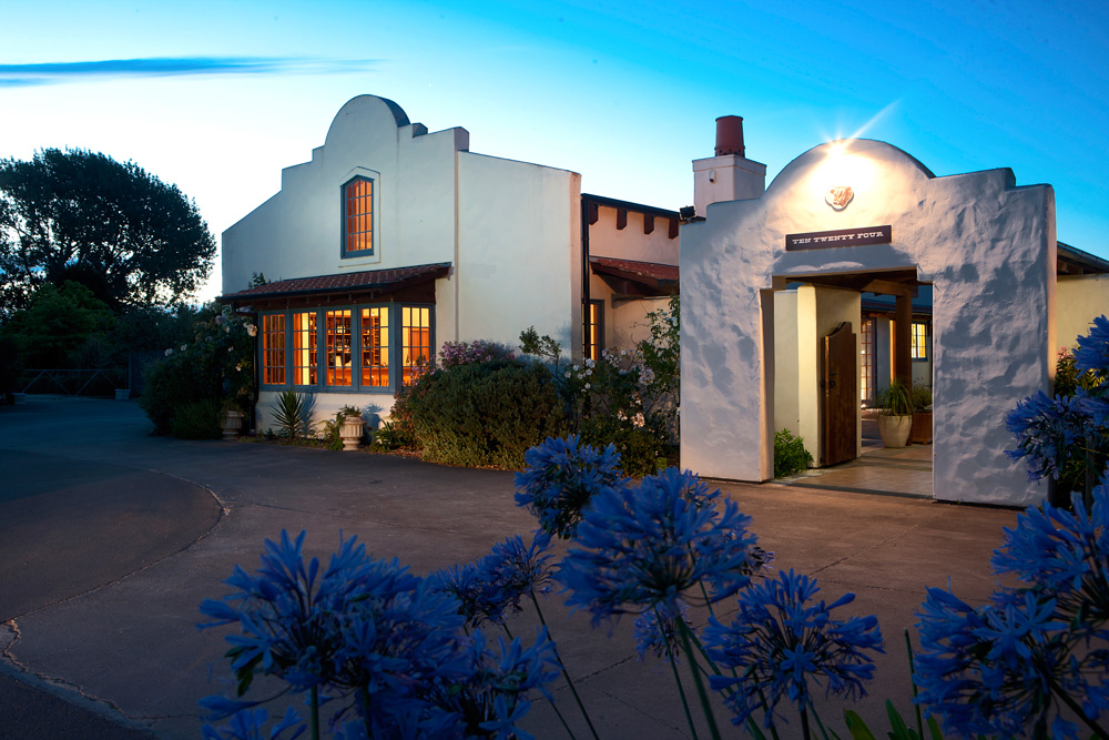 Kent Baddeley's Ten Twenty Four restaurant is faux-Arizona: plastered walls, terracotta tiles, and big wooden beams holding everything up.